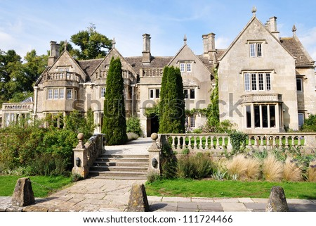 Exterior and Garden of a Victorian Era English Mansion - stock photo