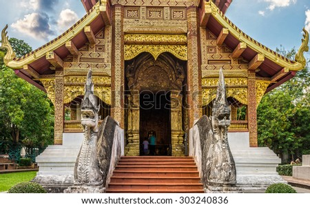 Exterior decorations of stairway and entrance in front of  Buddhist monastery of Wat Phra Sing Wora Maha Wihan. Wat Phra Sing is a Buddhist temple in Chiang Mai province, Northern Thailand. - stock photo