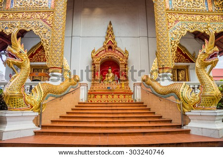 Exterior decorations of stairway and entrance in front of Wat Phra Sing Wora Maha Wihan. Wat Phra Sing is a Buddhist temple and the one landmark in Chiang Mai province, Northern Thailand. - stock photo