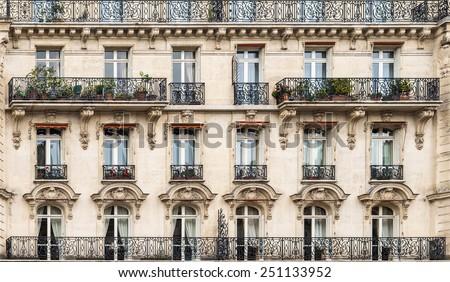 Exterior facade of a Parisian building. - stock photo