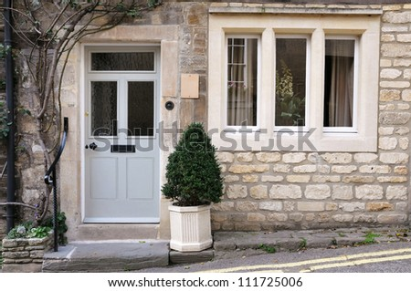 Exterior of a Beautiful Old English Stone Cottage - stock photo