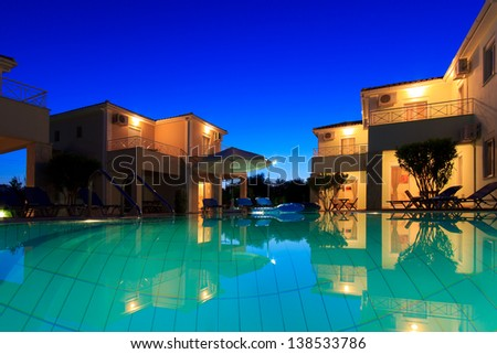 Exterior of a luxurious villa at Greek resort at dusk - stock photo