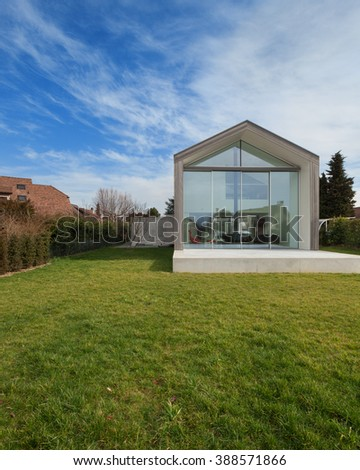 Exterior of a modern house, view from lawn - stock photo