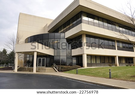 exterior of a modern office building with many windows - stock photo