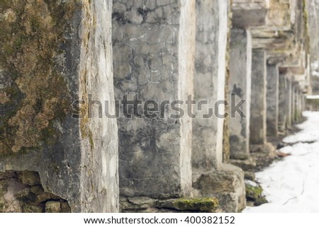 Exterior of abandoned industrial construction, blurred background - stock photo