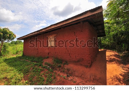 Exterior of an elementary school classroom in the Yilo Krobo District not far from Accra, Ghana. Dirt floor. Mud baked bricks building. - stock photo