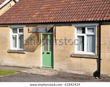 Exterior of an Old Bungalow cottage - stock photo