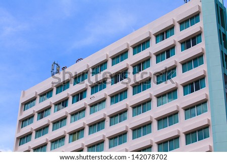 exterior of luxury hotel with blue sky.
