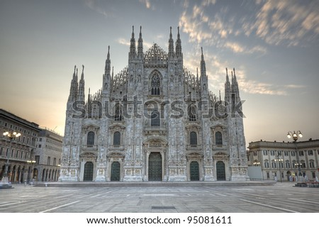 Exterior of Milan cathedral, the dome, duomo, illuminated at dusk, Lombardy, Italy - stock photo