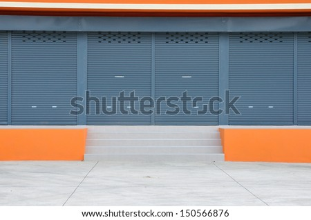 Exterior of new modern warehouse building. - stock photo