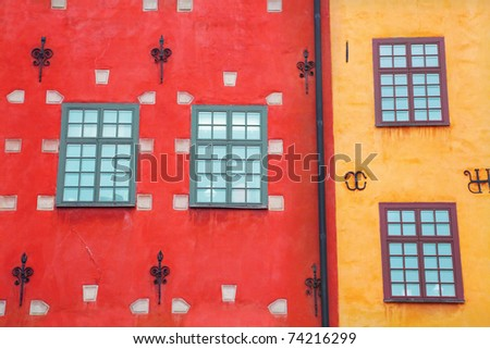 Exterior of old building with windows - stock photo