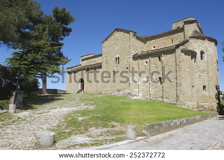 Exterior of the medieval cathedral of San Leo in San Leo, Italy. Cathedral of San Leo was built in 12th century. - stock photo