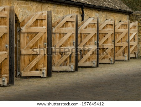 Exterior open wooden doors with curved tops - stock photo