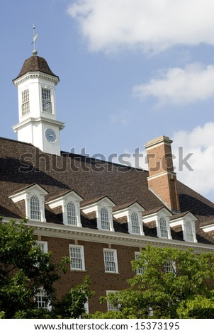 Exterior shot of a colonial-style brick building. - stock photo
