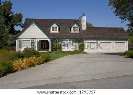 Exterior shot of a large suburban home. - stock photo