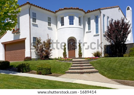 Exterior shot of a new, Spanish of Mediterranean styled home. - stock photo