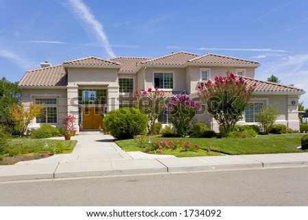 Exterior shot of a recently constructed home that shows great attention to detail in it's design and construction. - stock photo