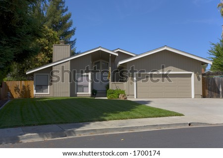 Exterior shot of a recently remodeled single story contemporary home. - stock photo