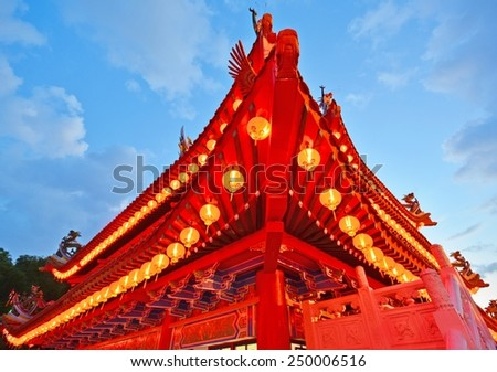 Exterior shot of roof Chinese temple with the red lanterns. - stock photo