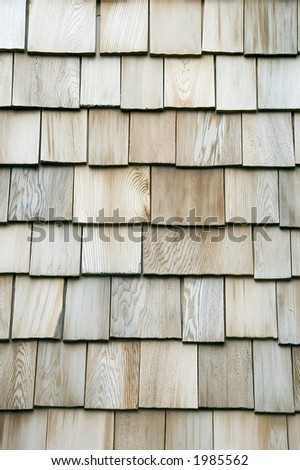 Exterior siding of wooden shingles - stock photo