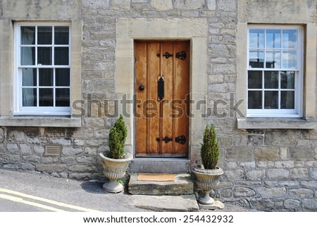 Exterior View of an Old English Stone Cottage Exterior Built Circa 1750 - stock photo