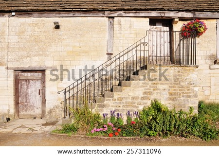 Exterior View of an Old Stone Barn - stock photo