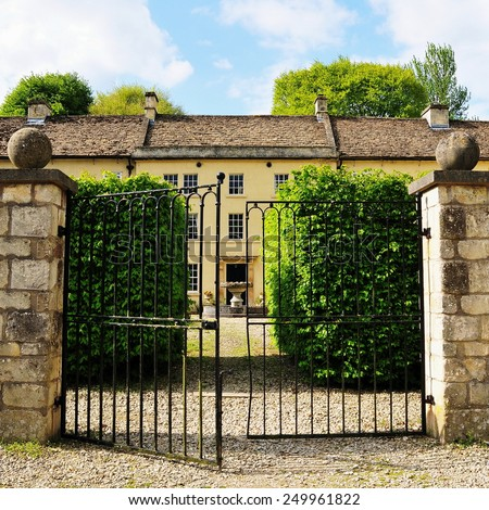Exterior View of Gateway and Entrance of a Beautiful Old English Manor House - stock photo