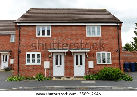 Exterior View of Red Brick Semi Detached Town Houses on a Typical English Residential Estate - stock photo