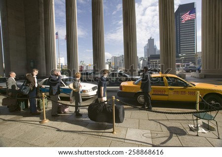 Exterior view of yellow taxi cab in front of the  30th Street Station, a national Register of Historic Places, AMTRAK Train Station in Philadelphia, PA - stock photo