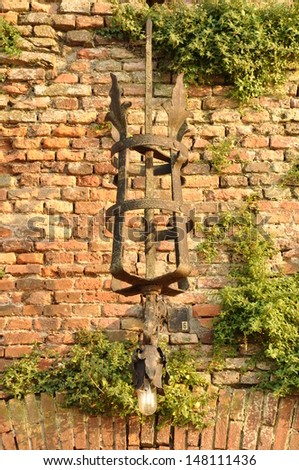 Exterior wall lamp on old wall, castle in Verona
