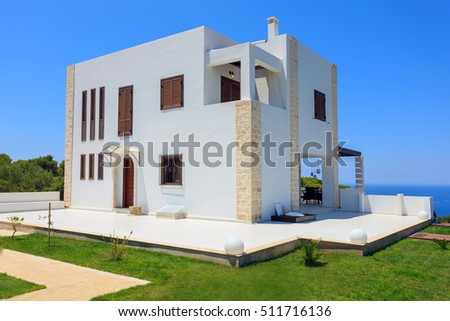 exterior with beautiful decoration of a luxury villa in the afternoon with sunset