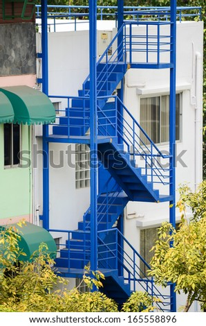 External blue fire escape staircase  - stock photo