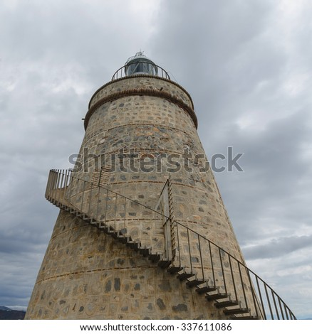 External caracole stairs in an old lighthouse - stock photo