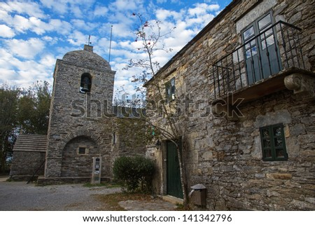 External Church stone pilgrims stop the Pilgrim (Camino de Santiago). Cebreiro. Lugo. Spain - stock photo