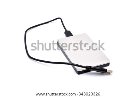 External hard disk drive isolated on white - stock photo