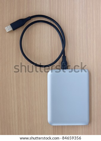 external hard disk with USB cable - stock photo