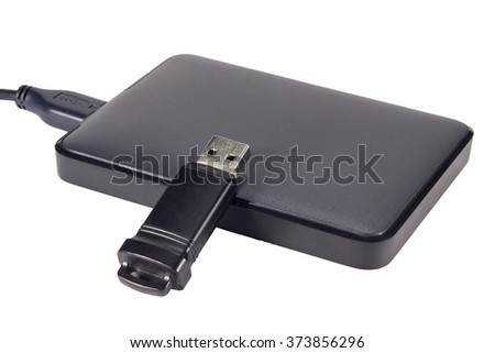 External hard drive and USB drive isolated on white background - stock photo
