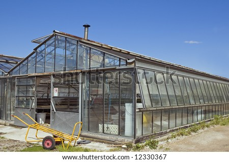 External view of a glasshouse against a blue sky