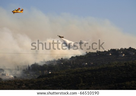 Extinguish forest fire on mountain Carmel in Israel - stock photo