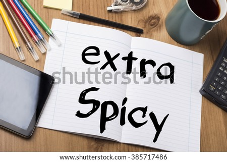 Extra spicy - Note Pad With Text On Wooden Table - with office  tools - stock photo