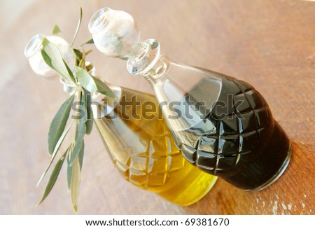 Extra virgin olive oil and balsamic vinegar on the wooden table - stock photo
