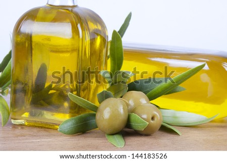 extra virgin olive oil and olives - stock photo