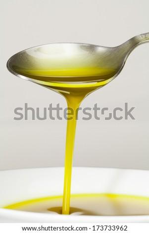 Extra virgin Olive Oil. Macro. - stock photo