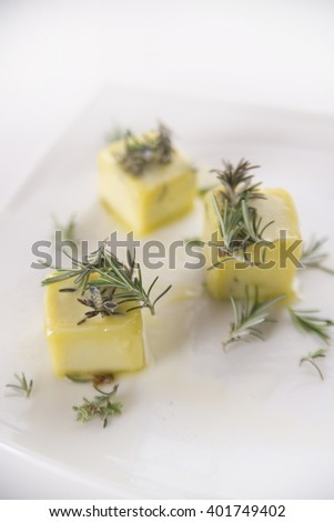 Extra virgin olive oil storage oil flavored with rosemary - stock photo