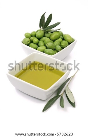 extra virgin olive oil with fresh green olives isolated on white