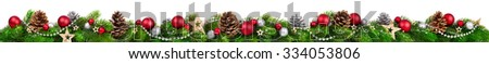 Extra wide Christmas border with fir branches, red and silver baubles, pine cones and other ornaments, isolated on white