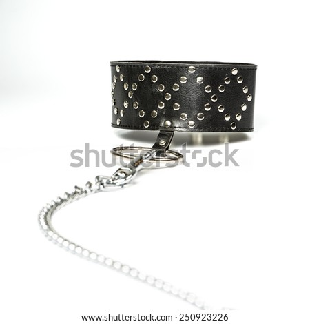 Extra wide leather collar with a rivets and a large metal ring - typical fetish wear. - stock photo