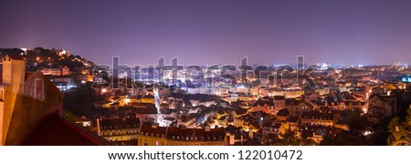 Extra-wide panoramic shot of Lisbon at night - stock photo