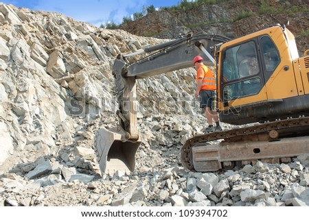 extraction of stone in the quarry - stock photo
