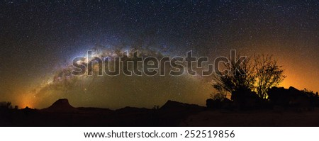 Extraordinary 180 degree nightscape panorama with the milky way seen from Isalo, Madagascar - stock photo
